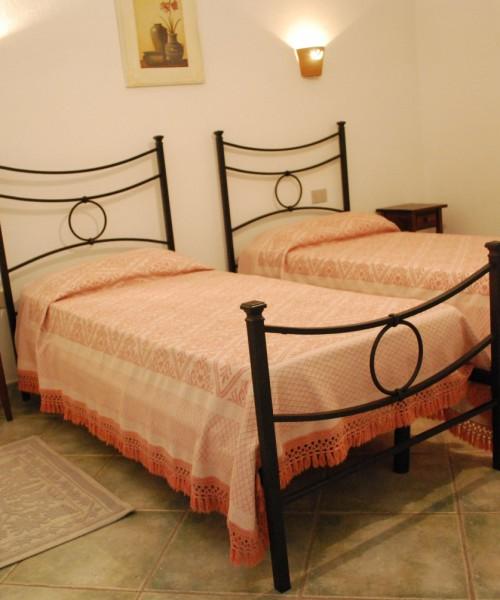 Camera doppia letti singoli Residence Oasi Blu